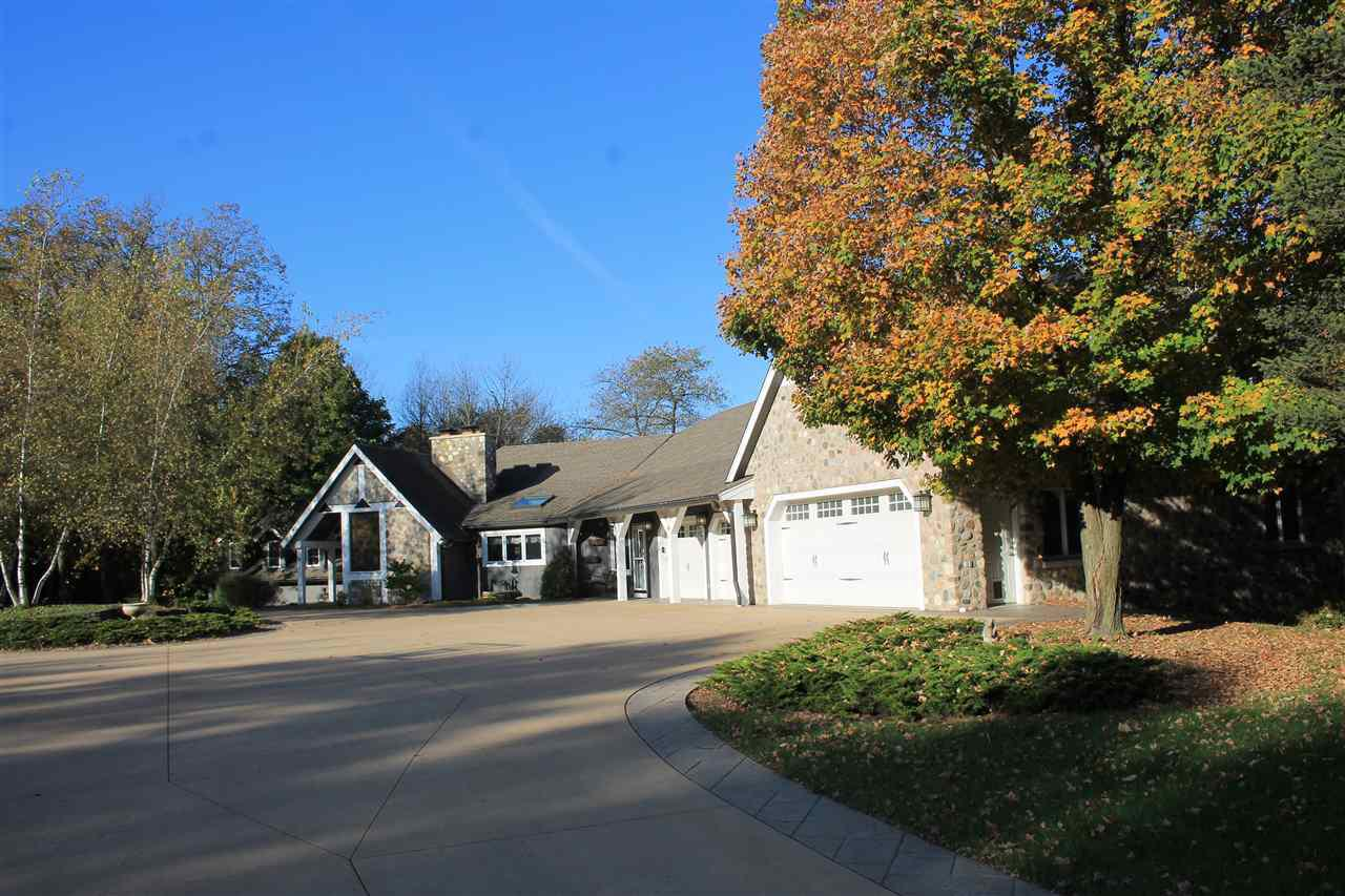 Featuring an executive estate that is truly impressive.  Large home with all the amendities you would expect in a custom home.  Gleaming hardwood floors, huge master ensuite with both his and hers walk in closets.  Large entertaining room with full wet bar and game room.  Million dollar views of large ponds and the conservancy.  Tons of garage space as well as another pole building for storing your toys. Large inground pool with a pool house and wet bar perfect for cooling down on those hot summer days. Exceptional hunting on the trophy bucks right out your back door.  This is truly every hunters dream home.