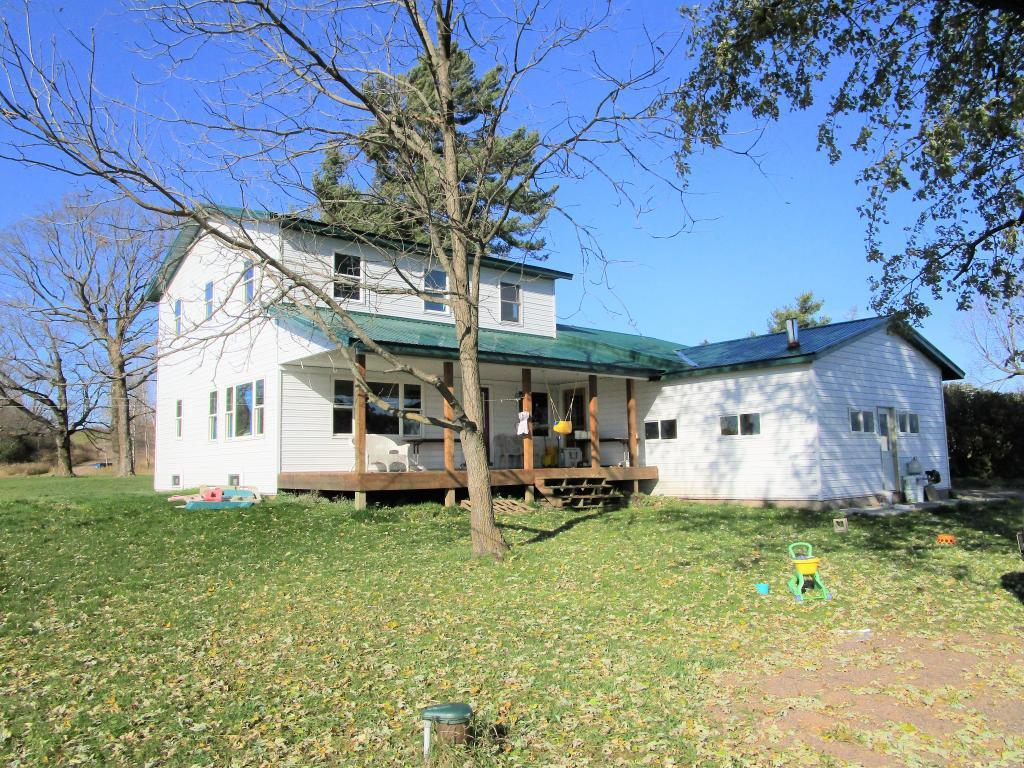 Big 6BR/2BA farm home on 190 acres east of Frederic. Newer home features open floor plan, huge kitchen with lots of cabinets, 2 main floor bedrooms, metal roof & maintenance-free steel siding. Outbuildings include large barn with lean-to, 64x96 pole shed & 28x40 insulated detached garage. Land is some tillable, some wooded and approx. 100 acres of fenced pasture with several ponds and creeks winding through the property. Picturesque setting and a great set-up for a hobby farm - come see!