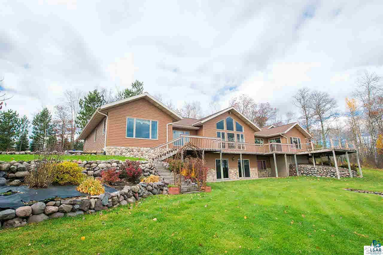 Upper St. Croix Lake luxury home with stunning views of the pristine wilderness from every window, gentle elevation to shoreline, beautiful landscaping. Convenient access for Twin Port travelers, 3 hours to Cities. Open floor plan with vaulted ceilings, massive views, large kitchen with center island and spacious dinning area. Enjoy the large maintenance free deck with unobstructed views. Lakeside Master Suite, fully finished walkout, tons of frontage/privacy. Pole building also available.