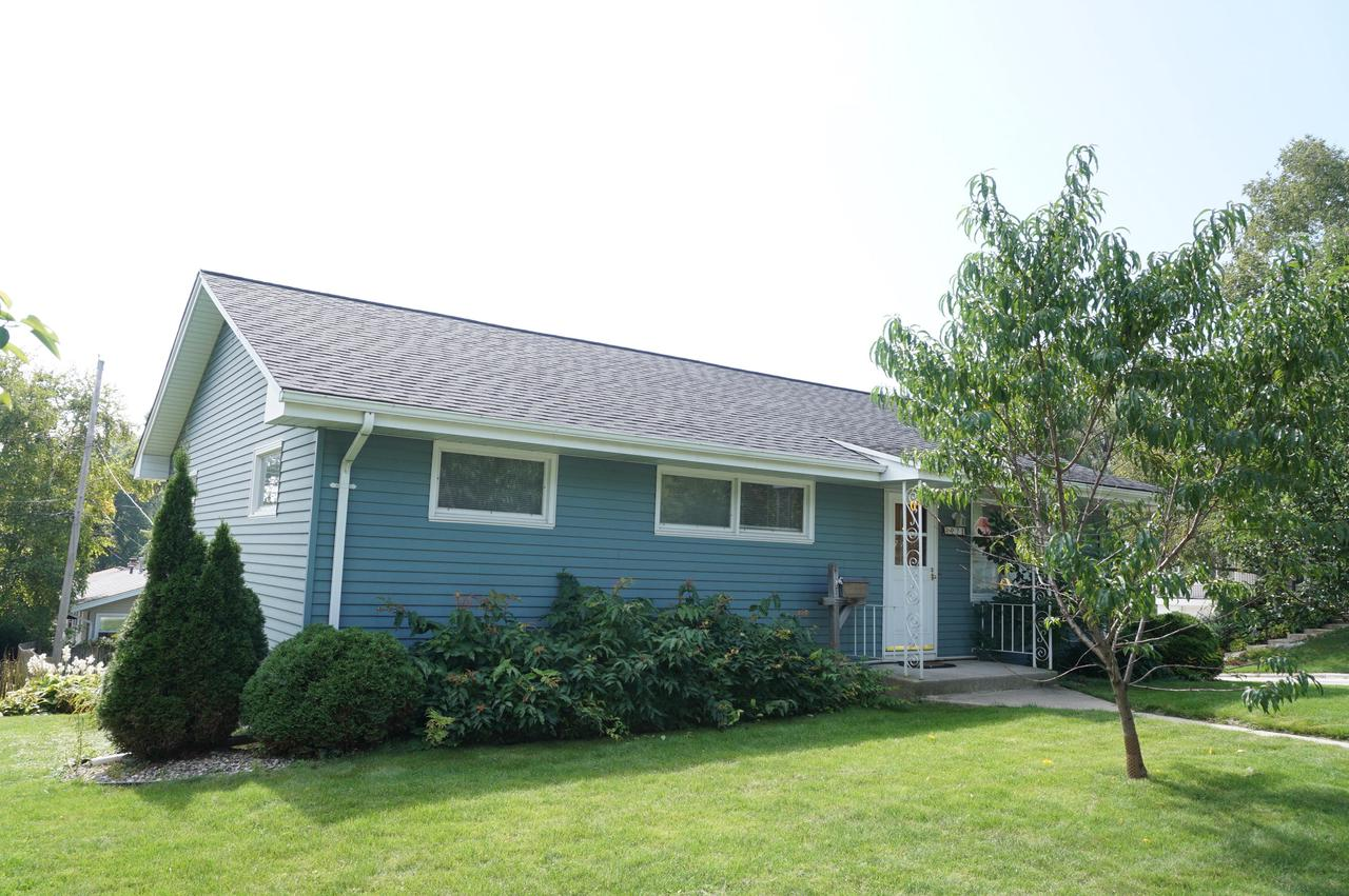 Wonderful 3br/1ba ranch gem situated in a great location, close to schools, interurban bike trail, parks, within walking distance to downtown and much more.  Enter the Cozy Great Room offering ceiling fan, Kitchen/Dinette combo offers Snack Bar, Laminate floors and all appliances.  3 nice size bedrooms with Hardwood Floors. Finished Recreation Room in lower great for relaxing or entertaining also a plus there is a walk-out to a patio.  Lower Level features a working toilet. Laundry in lower includes washer and dryer.  Lots of storage space.  This is a great home for the first time buyer -  Super price for a Super home.