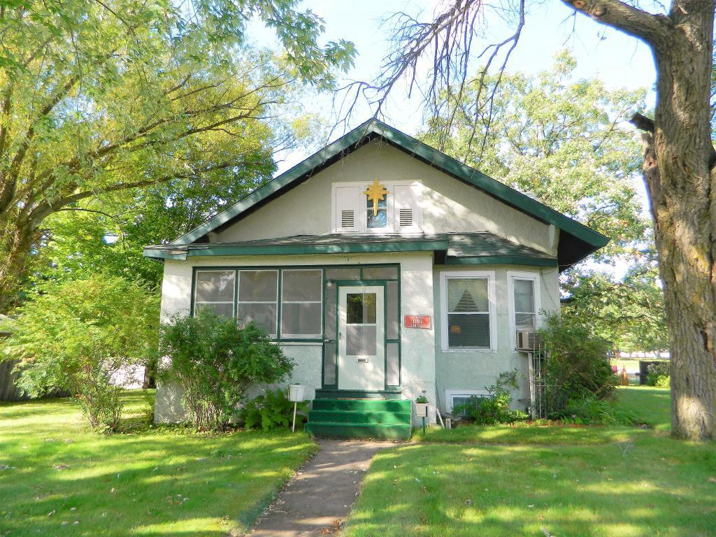 Nice, solid 4BR/1BA home on a corner lot in Lewis. Features lots of natural woodwork, large living room, kitchen & dining room, 2 main floor bedrooms, main floor full bathroom plus full basement. Stucco exterior and 1-car detached garage for parking and storage. Enjoy the enclosed front porch and relax on the big back entry deck and patio. Great property - come see
