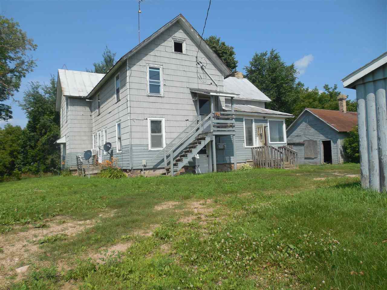 4-5 bedroom farmhouse, 2 full baths, barn, all on 5 acres.