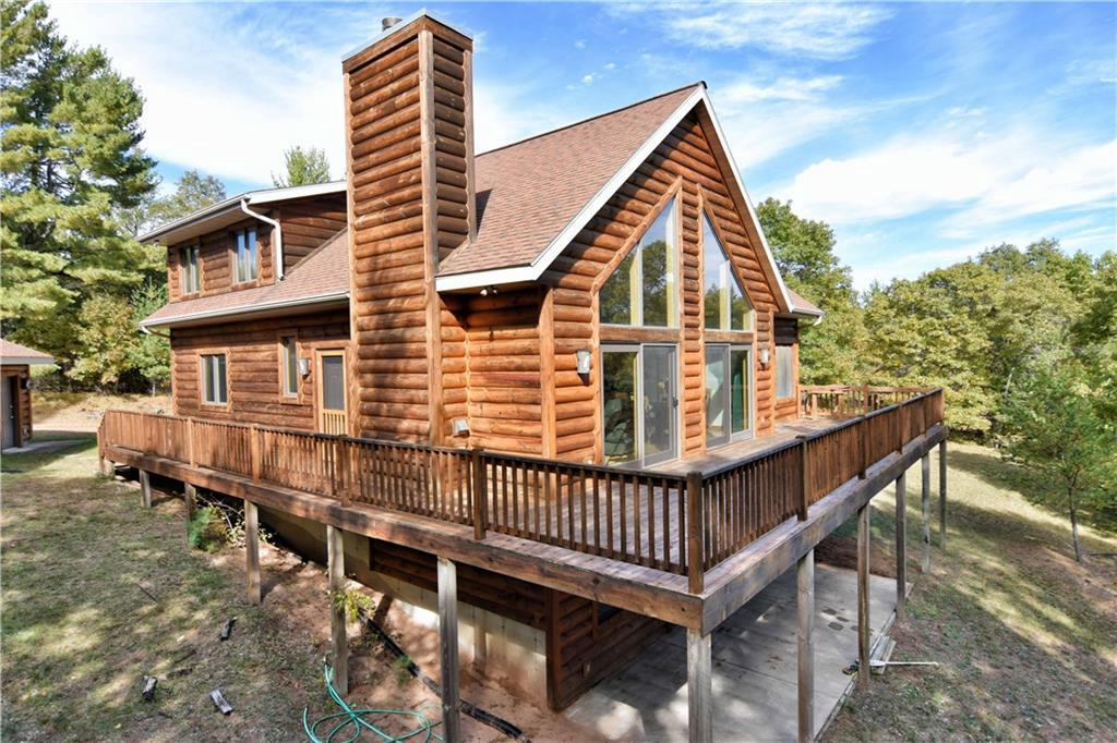 Rare opportunity to own 132 acres of pristine mature woods with very private Sherman lake 35 acres 11' deep, approx 3,500' of lake shore & approx 1,600' of river frontage.Lake has been known to produce some great fishing.Turn Key with a newer Chalet walk out 2900 sg ft 4 bed,3 bath home,decking,3 season porch, 2 stall detached garage,Includes furnishings. Watch Abundance of wildlife loons, deer, bear, turkeys,ducks, geese. Enjoy the 4 season with a 18 hole golf course, ATV/ snowmobile trails, hunting and fishing. Additional lake frontage available with this purchase if desire.
