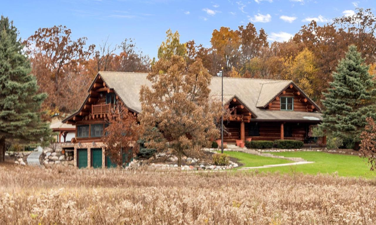 Rural oasis w/full log home only a few miles to downtown Lake Geneva! This 3 bedroom/ 3 bath home is nestled on nearly nine acres surrounded by mature trees and prairie land. Over 4000 sq ft custom built home features floor-to-ceiling stone fireplace & cathedral ceilings in great room. Kitchen with stainless appliances opens to spacious dining room. Beautiful main floor master with two-sided fireplace. Enjoy the beautiful grounds with in-ground pool & pavilion, firepit, gazebo, and massive front porch. Four car attached garage plus a 60x40 pole barn.