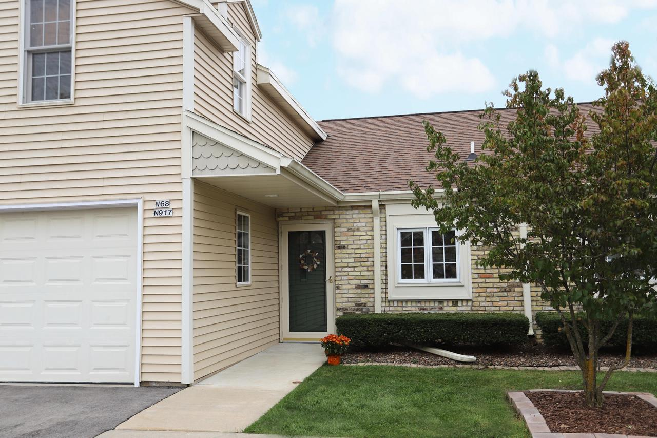 Great Cedarburg Location. Walk downtown to everything the city has to offer. Updated townhouse condominium. Open great room with Cathedral ceiling, hardwood floors, door to patio and 2 wayfireplace with Den. Kitchen has stainless steel appliances with pass-through to Dining area. 1st floor den could easily become a 3rd bedroom - just needs a closet. Full bath on both levels. New Air Conditioner in 2019.  Be part of the award winning Cedarburg Schools.