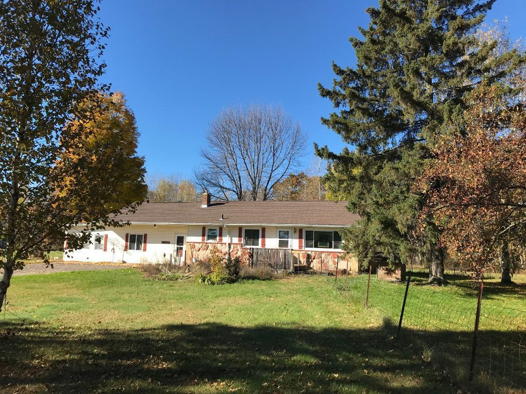 AMBERG---HOBBY FARM 34 acres with 2 bedroom, one bath home.  Roomy kitchen/dining area, and  nice carpeted living room having  fireplace but no chimney.  Third finished bedroom in basement.   Large cozy family room with wood heat and southern exposure sun room. 2 car garage,  barn with fenced pasture  and metal storage building.   Apx 1100 ft of Highway frontage.   Great for commercial venture.