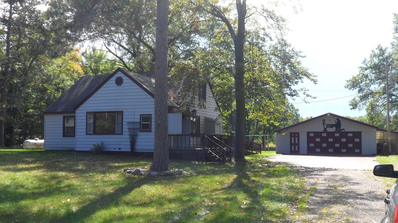 Hobby Farm, hunting camp, or year-around home you decide! 3 + bedrooms, 2 full baths, on 34 acres with open field and woods. Handicap ramp, full basement has washer/dryer, LP F/A Trane furnace is 1 1/2 years old, central air,  newer kitchen cabinets, slate tile floors, & a 26 x 42 heated  garage are additional features. Oh....I almost forgot the awesome she-shed with electricity, heat, t.g. walls, & slate tile floor! It's really cool! Check it out! *W26th Rd. is a ATV Route. *Being sold ''as is'' by Personal Rep.