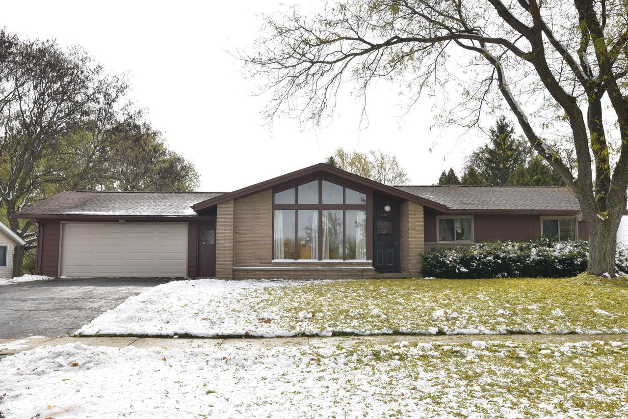 Updated mid-century ranch with an open feel with it's vaulted ceilings and wall of windows. Updated kitchen features granite counters, subway tiled back splash, modern light fixtures, black stainless fridge and d/w NEW in the last 2 years! New patio doors lead you to your large yard with attractive privacy fence (2017) and large custom 16'x12' shed on cement slab. Central Air 2018, new Garage door 2018. Hardwood floors in bdrms/hall, Master bdrm has master bath with tiled shower. New Broan fans in baths. Extra insulation blown in attic.  Roof, windows and water heater were ''newer'' when home purchased in 2016.  Fresh paint throughout, lovingly maintained...sellers just need more space for their growing family. Basement could easily be finished. Great location on South side of West Bend.