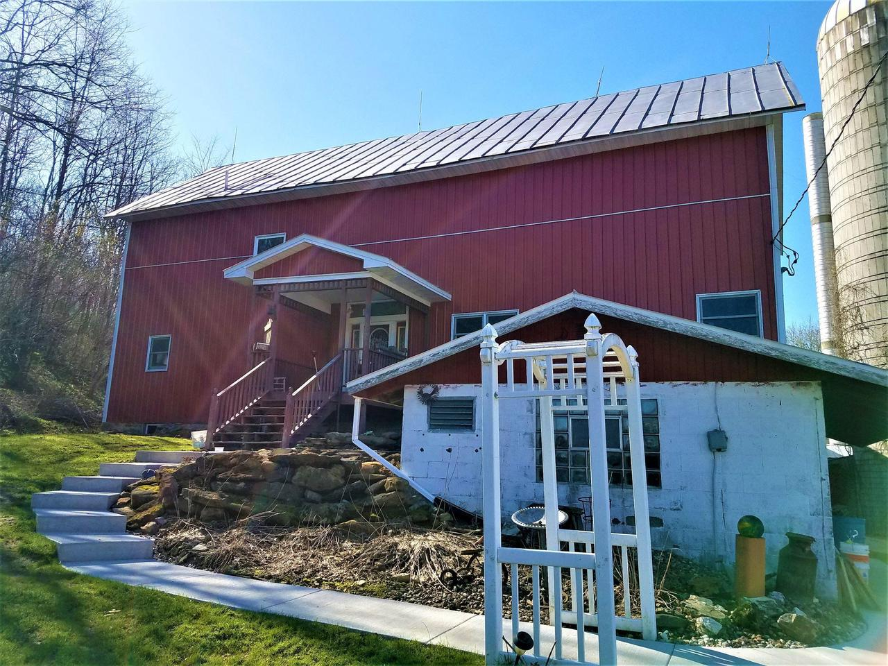 +/- 147 Acres with Barn Home and Buildings On a Dead End Road. This 4 BR 3 Bath Barn Home has an awesome large open layout on the Main Floor great for those large gatherings. The Beautiful Kitchen with an Islands opens up to the Living Room with an Amazing Fireplace. The 20x15 Master Bed with Vaulted Ceilings puts it over the top with a 11.5 x 7 walk in Closet. The property has multiple places for storing your toys including a 80x45 Pole Shed. The property is Located in QDMA neighborhood, with great success of bucks taken as well. The back 147 Acres has 9 small fields consisting from 2 acres field up to 6 acres fields. This gives you plenty of opportunities to be creative. The property has a fenced pasture and great trail access to accommodate any horse rider.
