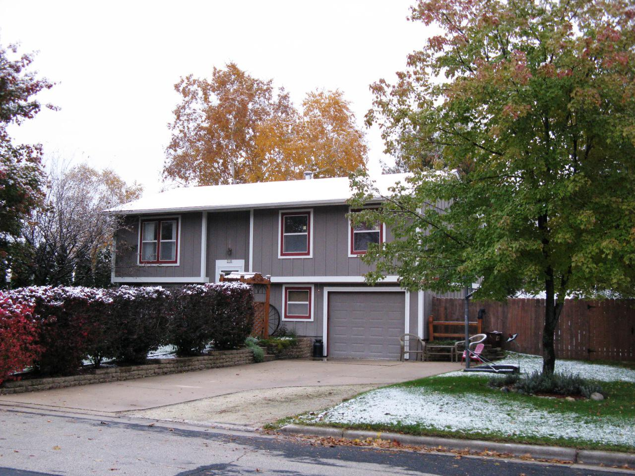 Be in your new home for the holidays! You will love the open concept living and dining room with newer laminate floor and access to deck, patio and spacious fenced backyard. Convenient kitchen with laminate floor and all appliances included. Two nice-sized bedrooms with newer carpet and updated full bath, master has newer carpet and master bath with walk-in shower. Large family room on the lower level with full sized windows and newer carpet, an updated half bath, great office/mud room off the attached 1.5 car garage and a laundry room with utility sink. The fenced backyard has plenty of room for entertaining with patio, play area, garden and large new storage shed.