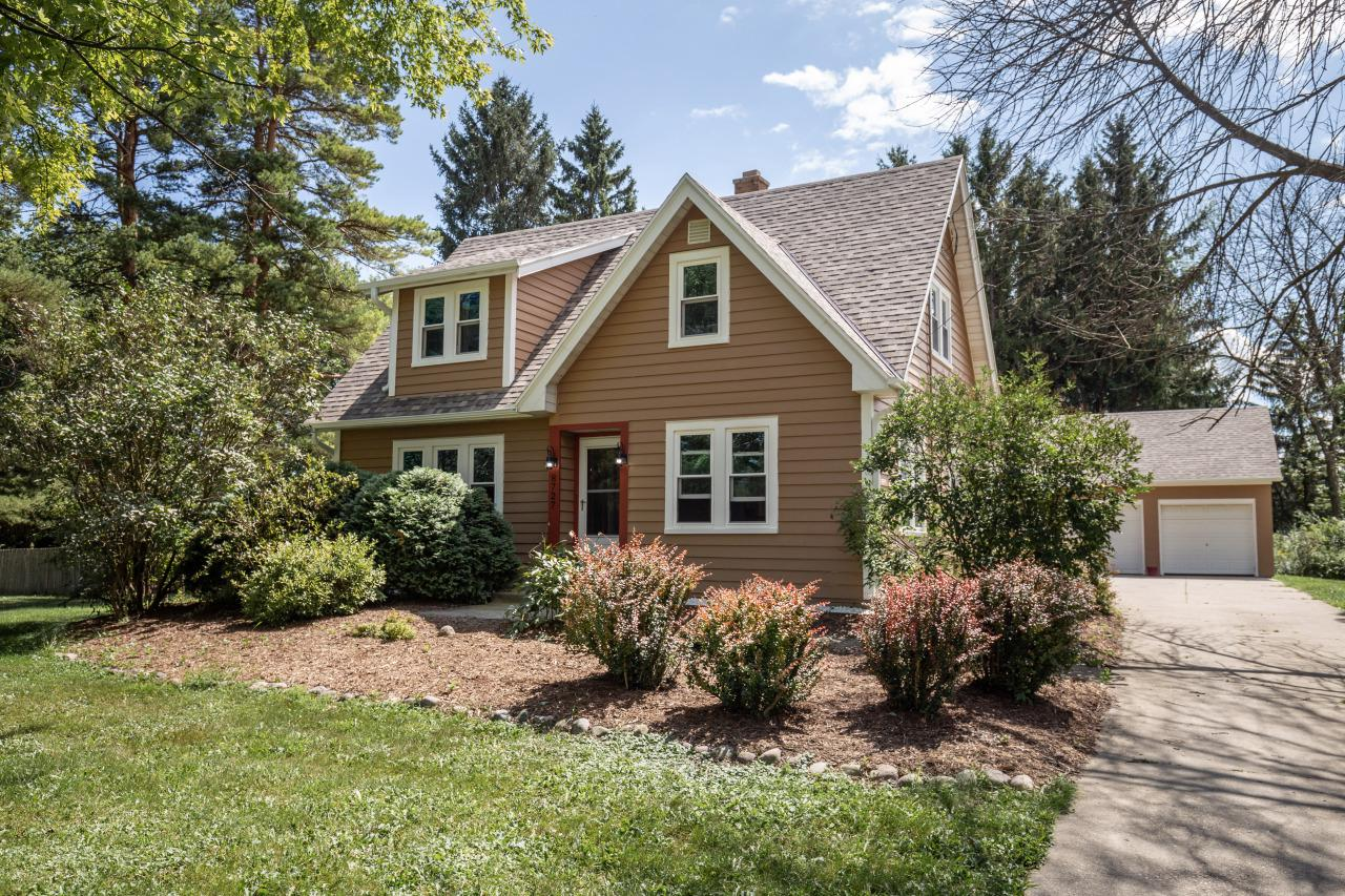 Don't miss this beautiful four bedroom, two bath Cape Cod home nestled on a spacious wooded lot. Meticulously maintained with hardwood floors throughout, gorgeous built-ins and newly-painted exterior. Relax on the wooden deck while you enjoy the privacy of your three-fourth acre lot. Close to excellent schools, new restaurants and a growing community. Enjoy a three car garage with turn around area making access to Mequon Road easy and safe. At this price, this home won't last long. Call to schedule a showing or to make an offer today.