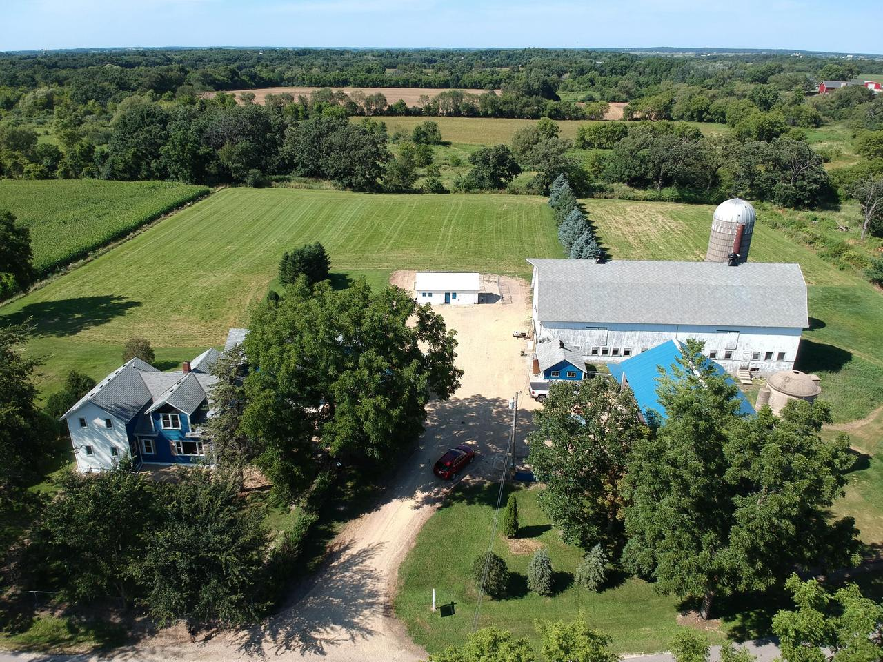VERY, VERY, VERY MOTIVATED SELLER!  BRING YOUR OFFERS!! Located off the beaten trail, 5 ACRES on Turtle Creek. Stop paying storage fees.  Save money by storing all of your equipment, boats, toys, cars and even animals.  There is room for all of it here. 3 garages; 32'x33'; 16'x20'; and 15'x30'.  There is also a 33'x100' barn that is in great shape.  You will be 1 mile from snowmobile trail, 2 miles from horse trails and in your back yard, enjoy kayaking or tubing down the beautiful Turtle Creek.  Enjoy boating? You are only 10 to 15 mile from area lakes. You can have everything in one location and live there too.  The 100 year old farm house features many updates.  Come enjoy the fresh country air and tranquil scenery that will surround you.