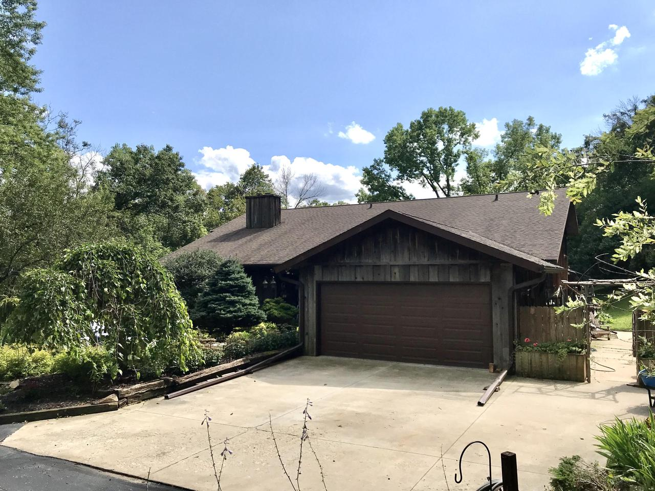 Terrific Cedar contemporary one owner home with 4brs, 3.5 baths on over 7.5 private wooded acres.  The home is surrounded with special walkways and gorgeous gardens.....and an above ground pool and decking for summer fun. This home has been loved and enjoyed for 50 years.  Three fireplaces, formal dining area and huge living room....big enough for a grand piano! Large welcoming foyer. Peaceful den, well appointed kitchen with custom cabinets and plenty of sunlight. Main level family room and rec room with custom built bar. Laundry room also has a walk in shower, stool and sink.  Barn on lower part of land is being sold as is.  Master suite features double sinks, and walk in dressing area.  Three other good size bedrooms and large main bath.Home Warranty included.  Horses are allowed .