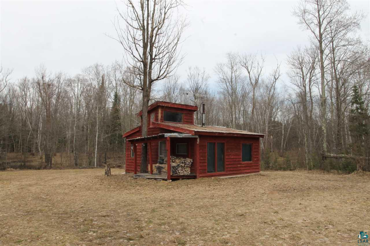 Northwoods hunting cabin on a heavily wooded 35 acres. Cabin does have power but no well or septic. Kitchen/living room, main floor bedroom with bunk beds and a loft sleeping area. Land is a mix of cedar and hardwoods.