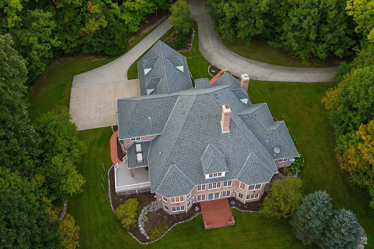 Spectacular 46 Acre totally updated all brick luxurious colonial w/sun filled dramatic open floor plan. Grand open 2 story foyer entry greets you with a 2 story floating bridge hallway, massive 2 story GR RM, full granite bar & wall of windows overlooking countryside of towering trees & pines. 1st fl MA BR is oversized w/spectacular views, luxurious MA BA w/large walk-in shower. Newly updated chef's island KIT with sub-zero fridge, spacious dinette w/sitting area & patio drs leading to covered deck w/skylights. Beautifully appointed cherry wood library w/NFP, BIBC & French pocket drs off foyer, upstairs features loft overlooking GR RM/foyer, 2 oversized BRMS w/bonus RM and Jack/Jill bathroom. Walkout LL  w/BR, EX RM. FR w/wet bar, patio drs to brick patio terrace, theater RM/billiards