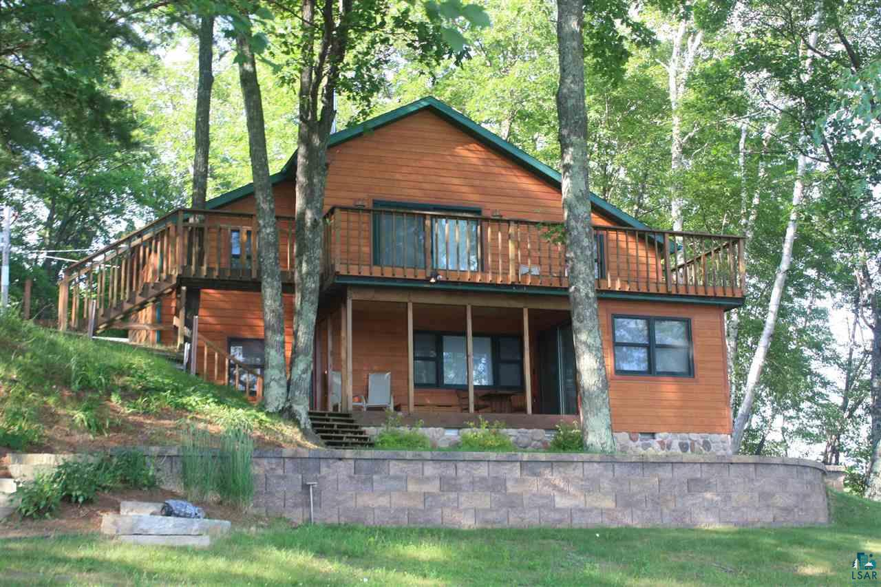 Rest and relaxation is what you will find at this comfortable and cozy lake home or weekend get-a-way.  This property offers nearly 250? of frontage and 3 acres of land on beautiful crystal clear Bass Lake, which is a no wake lake just outside of Iron River.  If you are in search of peace and tranquility you will find it here with fantastic lake views, sunshine from morning to night and sandy swimming beach that is perfect for the children and grandkids!  As your day winds down from the swimming and water fun it will be time to build a fire in the large brick surrounded fire pit and get the grill going.  You will be able to relax and settle in as you listen to the whip-poor-wills, mystic loon calls and frogs croaking. Inside you will appreciate the craftsmanship and quality materials used when this home was completely renovated. The kitchen boasts alder cabinets, granite counter tops w/large breakfast bar, top of the line appliances and maple hardwood floors. The full bath features beautiful ceramic tile floors and tub surround.   As you head upstairs you will be pleasantly surprised at all the options you have for this spacious room ? it can be your master suite, family room, office or all of the above! It?s that big! You will appreciate the built-in cabinets and immediate access to the large deck overlooking the beach and entire lake. There is easy access to the grill on the covered porch and then venture down the landscaped walkway to the fire pit and shoreline! As an added bonus you will love your own elevated picnic area that is perfect for a tent site or with a little work a camper site that overlooks the entire property.  All this and you are only minutes from Hyde?s Supper Club, downtown Iron River, the Pike Chain and atv, utv and snowmobile trails. Come take a look and see all the amenities to get excited about!