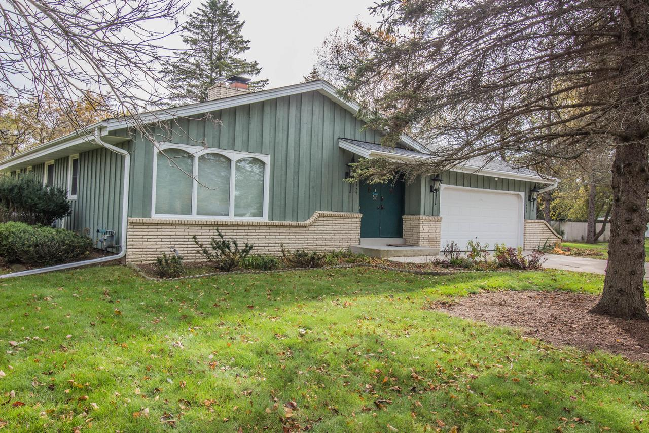 Location, Location, Location!  This 3 bedroom 2.5 bathroom ranch style home is situated on a park-like, acre & a half lot all while having great proximity to everything Mequon has to offer....shopping, restaurants, parks, schools & more. Minutes from I-43 for commuters. Features include an open concept kitchen that flows into the family room. Enjoy cozy evenings in either the family room or living room with the dual sided natural fireplace. Dining room is spacious & has time period built-ins. Entertaining is a breeze with the finished lower level that has a bar, full bathroom & electric fireplace. Master bedroom has ensuite with a powder room. 1st floor laundry is a plus. This home has a ton of storage with 2 massive cedar closets & an additional unfinished area w/ shelving. Welcome Home!