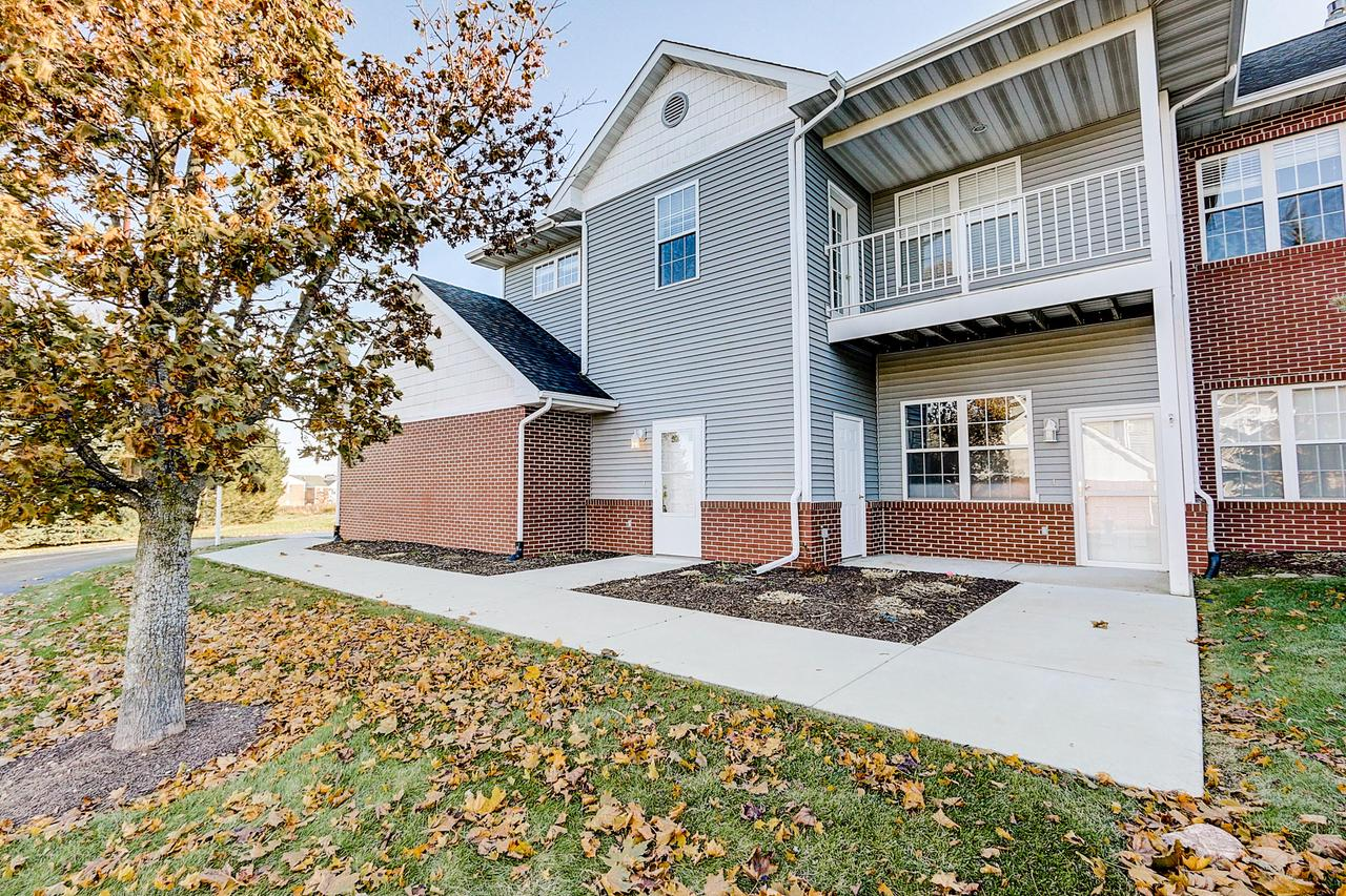 Light and bright, open concept two bedroom, 2 bath with square footage and layout that lives like a single family but provides the conveniences and advantages of condo life. With your own private garage and entrance this corner unit is move in ready! Extra wide stairway leads to the spacious eat-in kitchen with breakfast bar that overlooks the comfortable living room with tiled gas fireplace. Master suite features a generously sized walk-in closet, private bath with dual sinks, walk-in shower and lovely jetted tub. The second bedroom is roomy with ample closet space. This unit has additional living space that can be a cozy den, office or even another bedroom! Enjoy the extras of having your own private balcony. Bonus of brand new carpeting through-out the entire unit