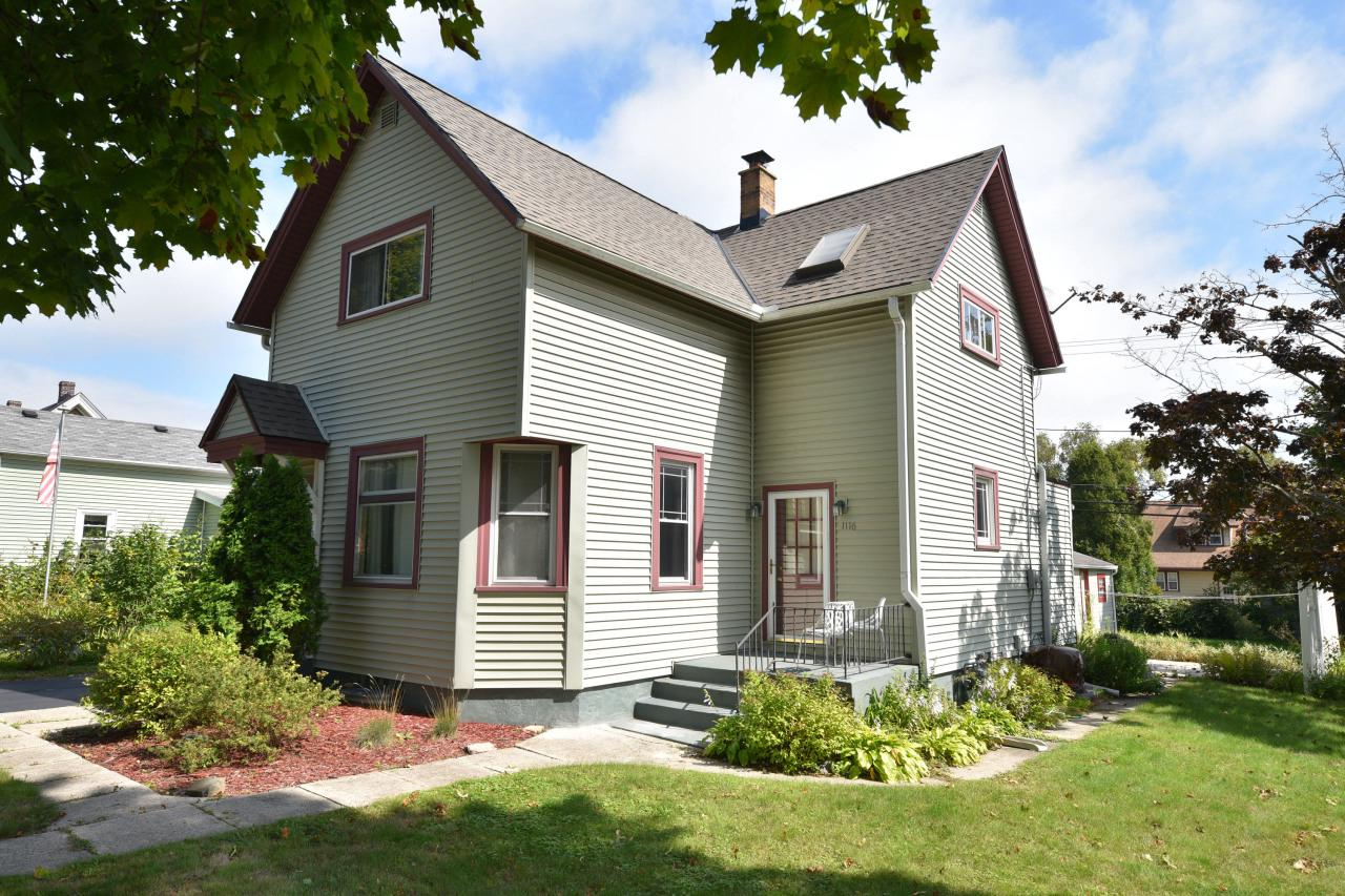 Charming updated home in walking distance to all the cool shoppes of Grafton! Come see this 3 bedroom, two bath home! 3 generous bedrooms and one bath are located upstairs. Main level has both living room and family room and large eat-in kitchen with plenty of cabinet space, and second full bath. Lower level has second family room area and includes new water softener. Garage has been restored with new truss system and new windows. Cute yard and patio ready for entertaining! Easy freeway access! Come find a place called home!