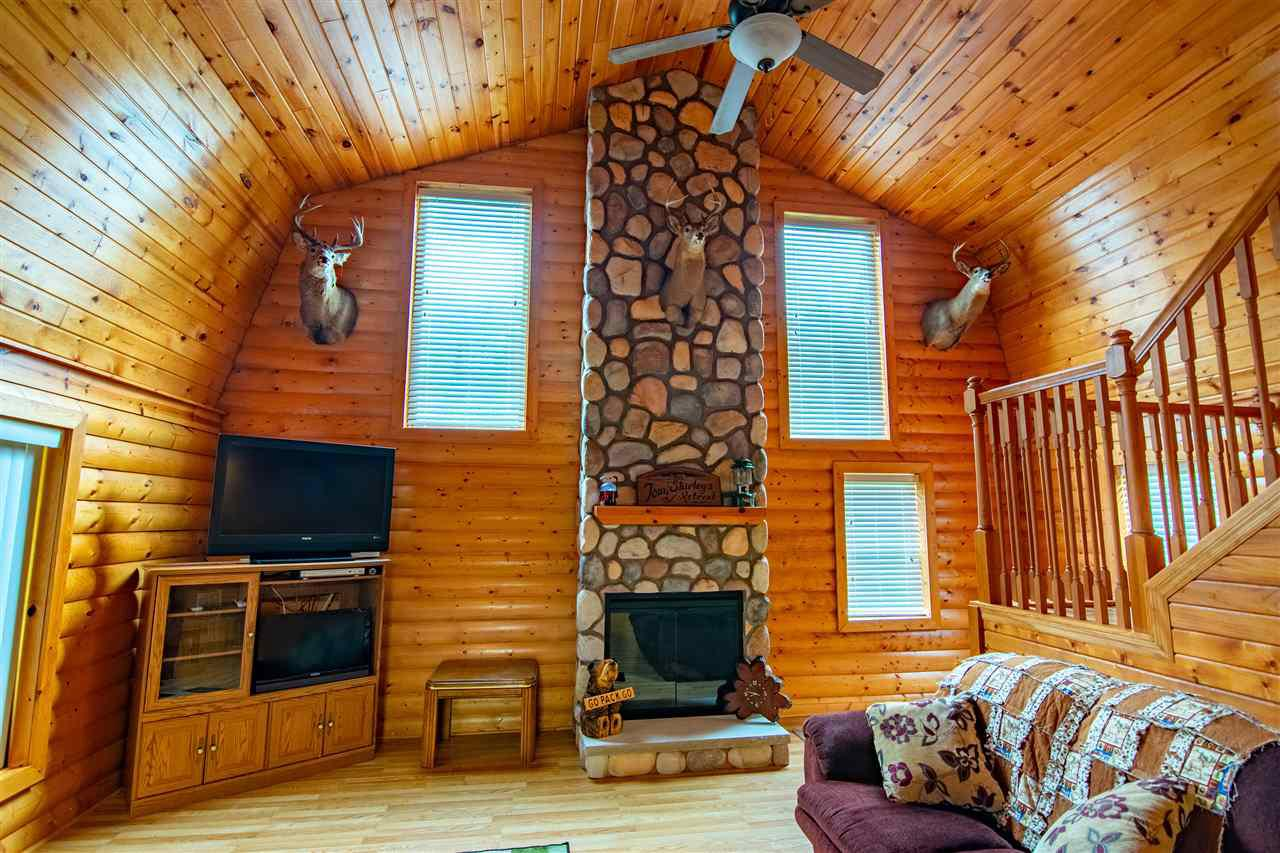 This hidden gem could be yours!  Hand-hewn cabin frame was build in 2007, and the interior was finished in 2019- Brand New!  4-season home or cabin is move-in ready with all the comforts you could want.  A gorgeous electric fireplace makes for a very relaxing getaway!  This house is also very well-insulated, and can easily maintain temperature with only the fireplace!   Wildlife that walks through your yard, road access to all 5 acres, and a quality built home!  Hunting is only steps away!,Well was drilled 2 years ago.  Dual-chamber septic holding tank was installed 4 years ago, and is all set up for a mound system if desired.  Top quality materials used in the construction.  Rustic on the outside, and super comfortable on the inside.  There is a wi-fi ready security camera system that is on the property(including camera in the woods by the food plot!), and a monitor in the living room so you can watch the deer feed, AND watch TV at the same time!  This system is not included in the sale price, but is a negotiable item.  Seller is also including one 100-pound LP tank with the sale.