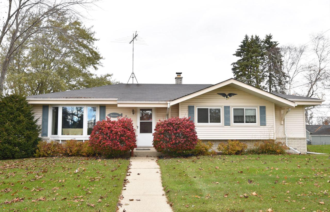 Great location for this ranch home looking for new owners. Well cared for and lots of happy memories made in this home.  Spacious kitchen, living room and dining ''L'', could use someones own touches. Bedrooms all feature Oak floors, master is carpeted but there is Oak under the carpet. Basement has a great ''retro'' bar and Rec. Room area as well as a wonderful workshop area. Most of the windows are newer and furnace is 2013.  Large deck and fenced yard. Garage is detached and needs some TLC.  This home is VERY livable as is, but would really be awesome with your own touches!