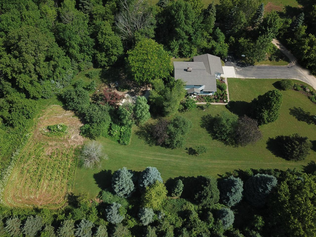 Have you been looking for a house with acreage? This 3 BR 1.5 BA, 2 car garage home comes with 16 acres...6 are wooded, 6 are Pasture/ag. and the other 4 acres are where the home and outbuildings are located. This hard to find property has 2 spring fed ponds, acres of woods to hunt in and is fully fenced in for grazing for horses and cows. 2 huge, heated garage /outbuildings (1 is 40x80), tons of fruit trees and beautiful flowering shrubs and perennials surround the property. Centrally located 20 minutes to Sheboygan or Manitowoc and 1/2 mile from Wilke Lake. If you're interested in a peaceful, private setting...this could be it!
