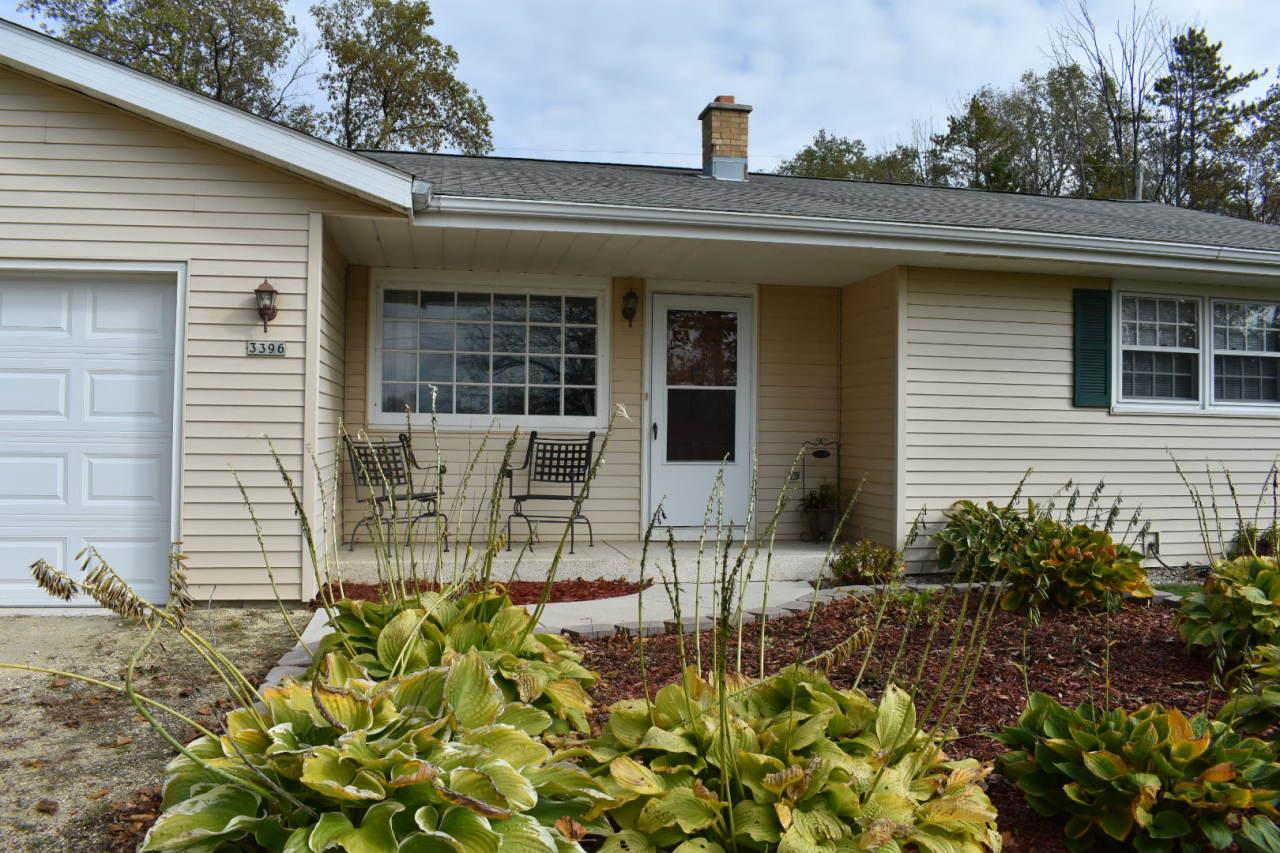 Stand alone country side by side condo on private wooded setting. No condo dues, pets allowed, full basement, and main floor laundry with this 2 bedroom updated large full bath condo. Great front and back views with open floor plan in living, dining, and kitchen. All appliances included, including washer and dryer located on the main floor. Nice attached 1.5 car garage with epoxied floor. Double closets plus another closet in the master bedroom. Nice sized second bedroom. Backyard is private with a patio and fire pit, with patio furniture included. Lots of parking offered here too. Home is warrantied.