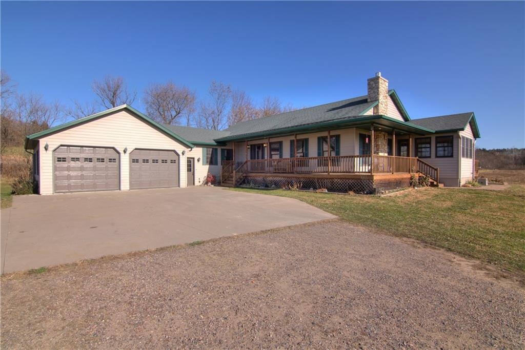 STUNNING HORSE PROPERTY w/3 deluxe stalls & workshop/3 car GA on 11+ Acres! Rural living only 7 minutes from Eau Claire & Fall Creek on Dead-End road. Quality, well maintained Rambling Ranch w/Att 2 car GA features 4 BDRM w/ WIC, 3 full BA, hardwood floors, central vac, 1st floor laundry, Cozy living room fireplace, open concept kitchen (w/pantry) to dining area w/walk out to deck for summer grilling & 4 season room for morning coffee, HUGE family room on LL w/ in floor heat. Fall Creek schools.