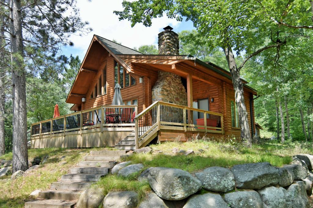 Charming impressive 3 level 4 bedroom full log chalet home nestled in a Northwood settling majestic pines nearly 18 acres parcel on a dead end road with trails thru out along with nearly 900 ft of lake frontage insures privacy. Adjacent to many wooded acres of county land. Vaulted ceilings make way from the floor to ceiling stone wood fireplace in living/dining rm overlooking the south facing lake & rap around decking. Main floor level has hard wood flooring thru out large bed rm, kitchen, sitting rm off living rm,check out the wine bottle rack. Large Master bedroom suite upper level. Lower level walkout delightful family room with bar, 2 bedroom, bath, laundry utility room.   2 plus detached garage, Great family retreat. enjoy the North woods