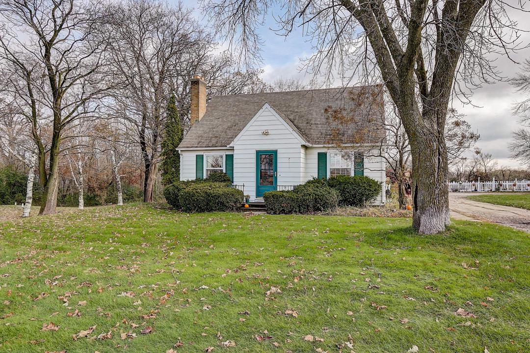 This charming 2 bedroom 2 bath Cape Cod is set upon a spacious 1.5 acre lot. With a detached additional garage  there is plenty of storage for all your toys. The second floor has a spacious master suite including full bath and great closet space. Lower level includes a rec room with bar and room for entertaining along with laundry and storage. Come fall in love.