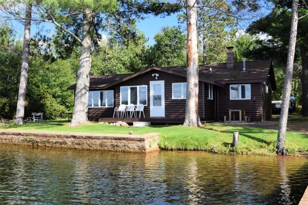 Charming nostalgic log sided 2 BR, 1 BA cabin has it all, including being sold completely turn-key w/rowboat!  444+ ft. of gorgeous level sand shoreline w/2 docks perfect sand bottom, 4.14 acres, tall majestic pines and on highly sought after 194-acre, 21' deep crystal-clear Horseshoe Lake near the Minong Flowage!  Absolutely perfect swimming and offers great fishing and boating. 2 car det. gar. w/lean-to and finished bunk space above and new septic 2019.  Interior of cabin is finished in all knotty pine w/laminate floor, nice sized kitchen w/island, dining nook & large living area. Incredible westerly views from the kitchen and just a stone's throw from the water's edge!  Blacktop drive, gorgeous park like setting, sauna house, privy and ATV & snowmobile trails galore! This is your perfect lake cottage!