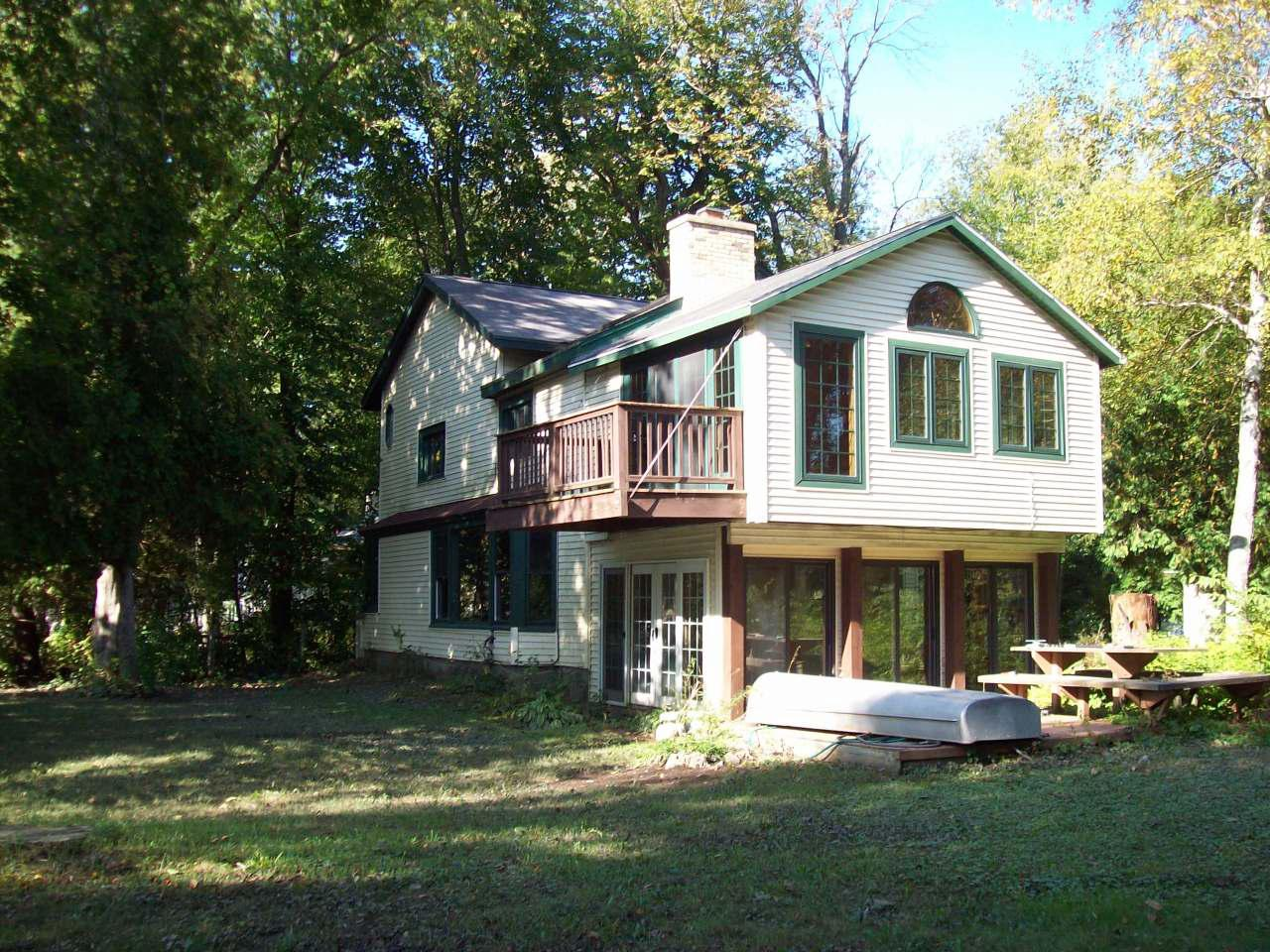 This private retreat offers tons of potential. Bring your tool box and remodeling enthusiasm to this beautiful river setting on navigable part of the Milwaukee River. Many activity options includes: boating, water skiing, swimming, fishing, ice skating, cross country skiing or just relax and take in the quiet beauty of the river. Other features this well-situated piece of property include are a three car garage, boat house and multiple storage sheds. With some imagination and effort this could be your dream home come true. Property is being sold by power of attorney. No property condition report will be provided.