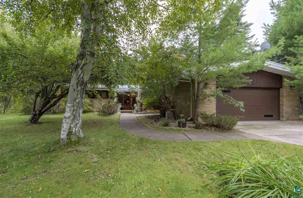 This is a beautiful brick Billings Drive home.  It features 110' of St Louis River frontage on a large private, treed lot.  There's a gorgeous 4-season windowed  sunroom, a large redwood patio overlooking the River.  This home is on City water and sewer.  It features new central air conditioning, a new furnace, the electrical has been updated, and the roof has been upgraded.  A vapor barrier has been installed in the crawl space.  Call for an appointment today.