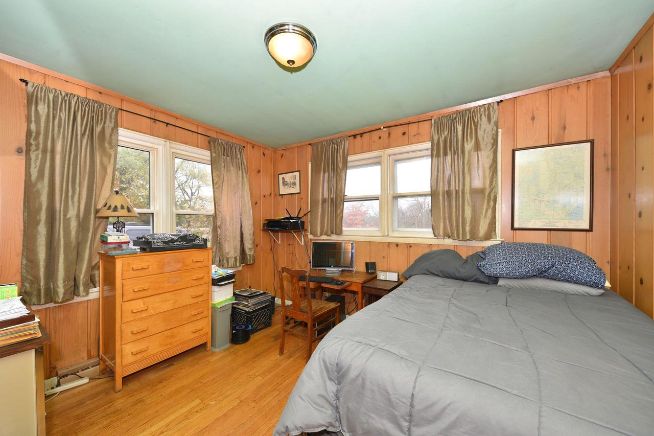 Rustic 3 bedroom Ranch on an a.83 acre lot.  This is the perfect starter home or downsizing option that has a country feel but is close to schools, parks and shopping.  Knotty pine paneling gives cottage look that accompanies such a beautiful large lot.  Very clean basement is ready for any of your rec room ideas to add living space and comes with wood burning stove!  Grafton schools!  Home Warranty included!