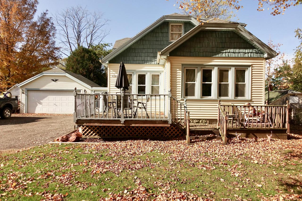 This beautiful 4 bedroom, 2 bathroom home is situated on half an acre and has many interior updates! Seller has cared for this home and it shows.  New laminate hardwood flooring throughout! Fresh paint throughout including freshly painted kitchen cabinets. Lower level bathroom has newly remodeled tile shower over tub! Upper bathroom has new walk-in shower! Enjoy your large fenced-in back yard with deck! Perfect for entertaining and for families with small children or pets! Mudroom/breezeway connects the two-car garage to home and is great for shoes and coats when the weather is nasty. Extra wide driveway offers additional parking.  Don't let this one slip away!