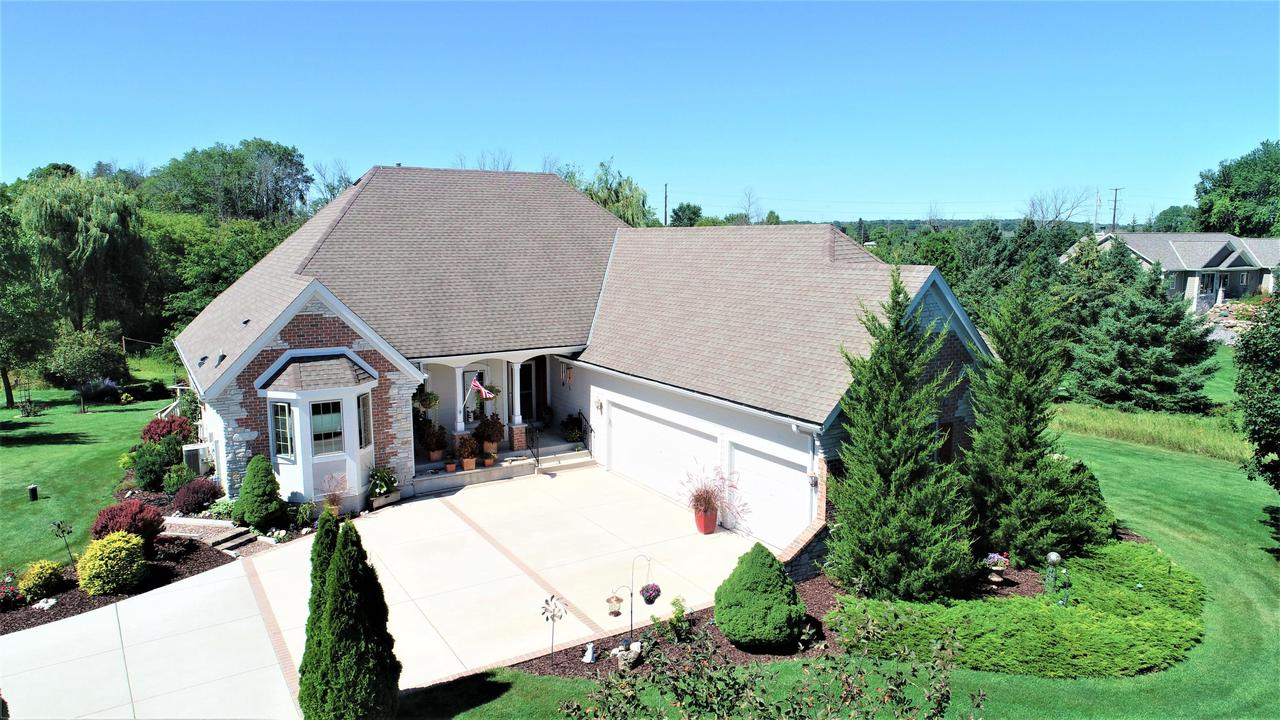 Secluded custom built open concept ranch on 3.31 acres with private pond! Enter the foyer to vaulted and coiffured ceilings ranging from 10-14 ft with amendoim hardwood floors.  Towering gr. room  with two way GFP and open view dining room for all your entertaining needs.  Massive kitchen offering birch cabinets, granite, custom lighting & SS appliances, snack bar + open dinette and tons of windows.  Large family room w/BIBC , patio doors to 2 level deck, + bonus Sunsetter  on huge picture window.  Master bedroom with vaulted ceilings w/ patio doors directly to deck, His/Her walk in & GFP . Updated master bath 2017 offering massive tile shower,(body spray & 2 shower heads) Kohler plb. ,quartz tops + free standing soaking tub. Lower Rec rec room and custom wet bar + 3 other large bedrooms!!