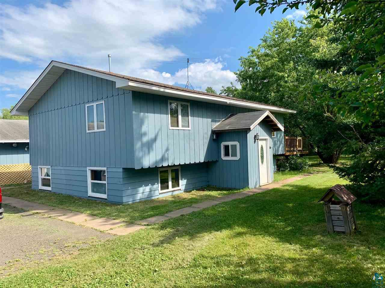Very spacious split entry on 6.8 acres. Amnicon area. Three bedroom and two bath. Four car garage with large storage area along back side. Large deck off kitchen overlooks park-like yard. This home has a relaxed country vibe.
