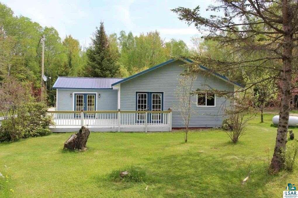 This property offers many great opportunities with a main house and a cottage.  Enjoy it all yourself or rent out part or all of the property for income. The zoning here is Residential/Residential Business so the sky is the limit! The location is at walking distance or a quick bike ride to Little Sand Bay park and boat launch and the Apostle Islands National Lake Shore, or a quick drive into the touristic heart of Bayfield where you will find restaurants, shops, groceries, and community. Many near-by farms and orchards offer fresh produce and fun!  The Main house (1,122 sq ft) offers a warm living area with French doors to the large deck. There is an open kitchen concept with a breakfast counter, glass top stove, microwave, stainless refrigerator/freezer, and dishwasher. The semi-formal dining area has a lovely cafe mural. The main house has two bedrooms and two baths. The master suite has an annex room and a 3/4 bath (handicap outfitted shower), while the guestroom has a full bath with jetted tub and separate shower.  There are French doors and stained glass windows in the living room and master bedroom. By the back entrance, there is a laundry/utility room with stacked washer and dryer, furnace, and water heater.   The cottage comes with an additional 800+ feet, where the living room gives access to the back deck. There is a generous kitchen with stainless steel fridge and dishwasher and glass top stove and eat-in counter. There is one bedroom and a full bath equipped with a classic footed bathtub (w/shower handle) as well as a separate shower, and washer/ dryer. The cottage has a covered wraparound porch.  The outdoor wood-burning boiler, is new and almost ready to go. With an accepted offer, the seller will have this system finalized to provide heat in the cottage.  The property is almost 2 acres of beautiful perennial flower beds and trees, which delight throughout the spring and summer months. There is a brand new storage shed for garden tools and mower.  Lots of work has been done to the property recently, and it is move-in or rental ready for the next owners.  It can be purchased fully furnished. If you are looking for a versatile income property on the Bayfield Peninsula you definitely need to see this property. Call for a showing!