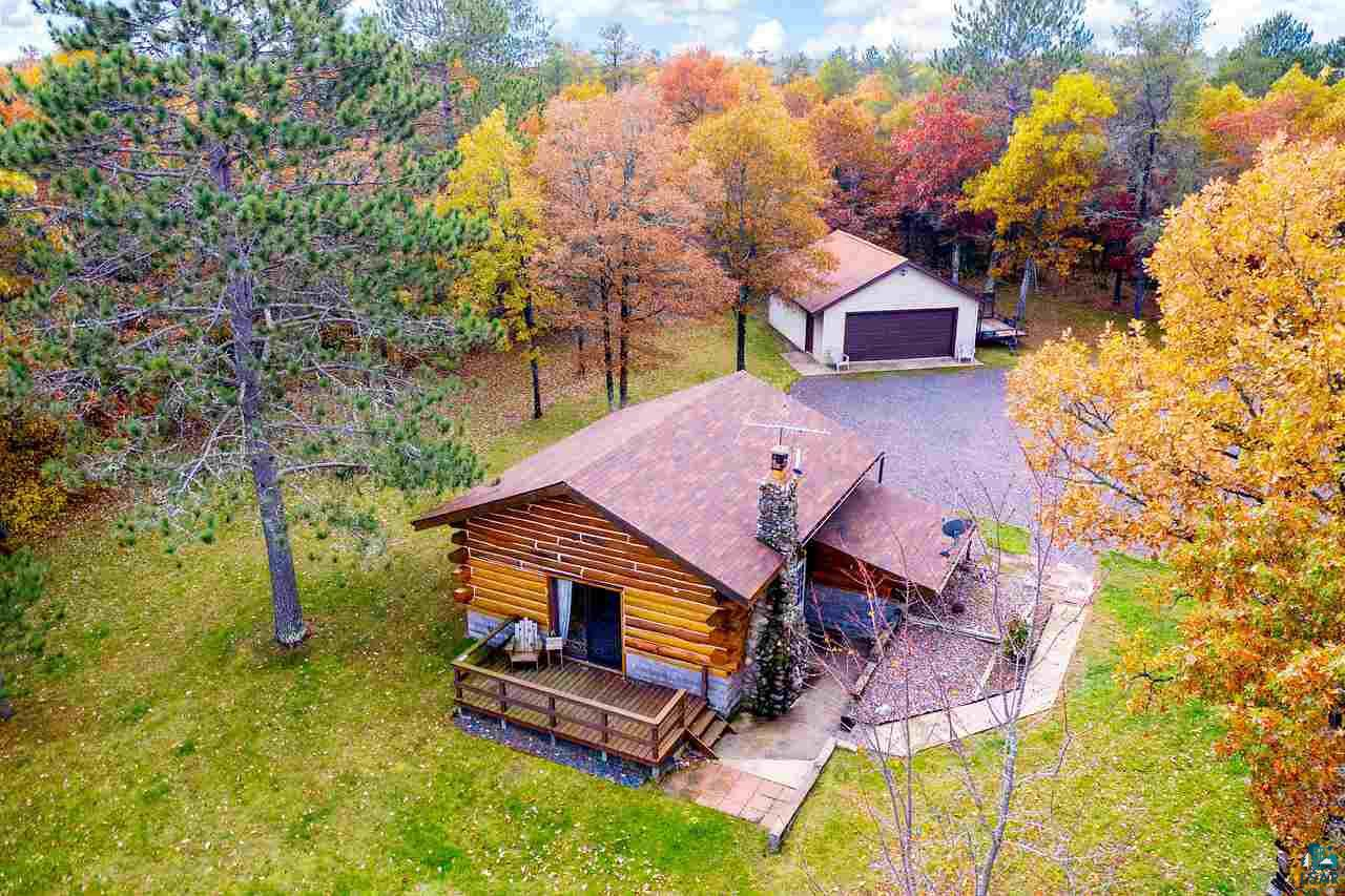 Excellent opportunity for acreage setting with amazing lake views! Your own personal retreat! Escape to this adorable log home on 1.52 acres with towering white pines & oak trees. Log home features vaulted ceilings, oversized kitchen/dining area w/ample storage and full bath. Raised living room has exceptional views of the lake plus a cozy wood burning stove/fireplace. Upper level loft/bedroom complete with storage closets and great views to below. Detached two car garage has a built in workbench & cabinets, plenty of room for guests with RV's/campers. Located on ATV route, minutes to golf course and hunting land nearby! Easy access to Bayfield/Ashland area, Hayward lakes area and North Shore!