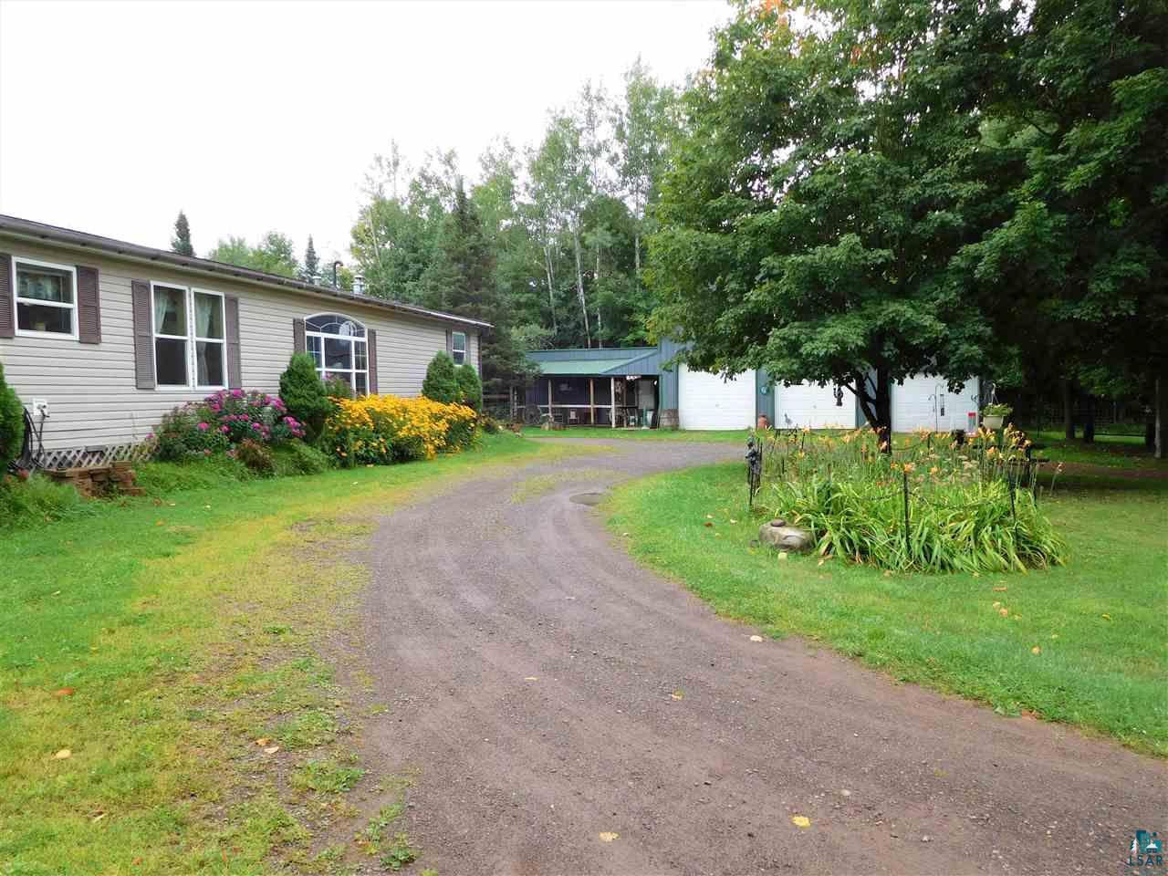 Down the road from Copper Falls, and an easy thirty-minute drive from Ashland (no city traffic or stop & go lights!), you'll love this property that's just under eight acres with a barn, chicken coop, numerous garden areas and trails throughout. The home has been added onto with a shared deck in the center which gives you many options & possibilities. Hobby Farm, Ranch, Air B&B, Offices, Studio Space, Mother-In-Law Suite? Plenty of space to spread out and enjoy two living rooms, kitchen with walk-in pantry, master bedroom with walk-in closet and attached bath with whirlpool tub, mudrooms, office, main floor laundry and much more. The barn has three doors to house vehicles and equipment, a tack room, work room and upstairs storage/hay area.  Rock the evenings away on a rocking chair under the covered porch while the horses saunter by.  Numerous perennials and herbs are here to get your gardening started, come take a look!