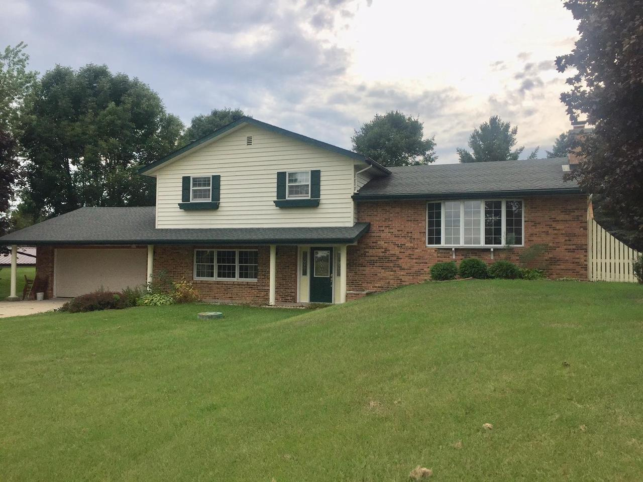 Excellent location!  This lovely home is located just outside of the city limits, but close to schools and city amenities!   Many nice features of this well built home include a LR with beautiful brick FP with wood mantel.  Nice size kitchen has quality cabinets and a nice size dinette.  The semi open concept floor plan includes a 3 season sunroom off on the dining area and a FR with woodstove off of the front entry!  The bedrooms are all spacious with large closets.  The MBR features a WIC and private bath with shower.  A main floor laundry with 1/2 bath has a door leading to the backyard.  This home has some nice updates and has great space and a beautiful park-like setting!  Don't miss out on a great property in a great location!  Room sizes are estimated.  More photos to follow...