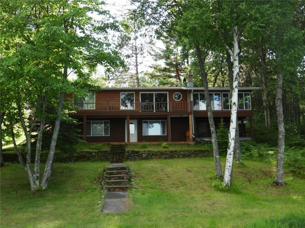 Awesome views of Robinson Lake from this immaculate totally remodeled home with lots of charm. Huge main bedroom with spacious walk-in closet. Built-in pantry off the kitchen. Take your boat down the channel to Birch Lake then go thru the culvert to crystal clear Upper Eau Claire Lake. Sand bottom and 123 feet of frontage to enjoy. Plenty of storage with the 3 car garage and shed/fish cleaning bldg. Furnishings negotiable. Access to recreational trails out the front door. Must see to appreciate!