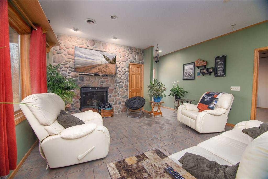 This is a  must see custom built home that boasts character throughout the home.Attention to detail proves itself through stone fire place, in-floor heat throughout and its open floor plan. 30x40 patio with built in fire pit to sit around and enjoy those nights  by the fire. Garage is heated and has in-floor heat.This home has  2400 square feet of comfort nestled into 3 acres with a Private setting.School District is Amery or Clayton no open enrollments to either school. Sellers pay Amery school tax their kids attend Clayton school district.