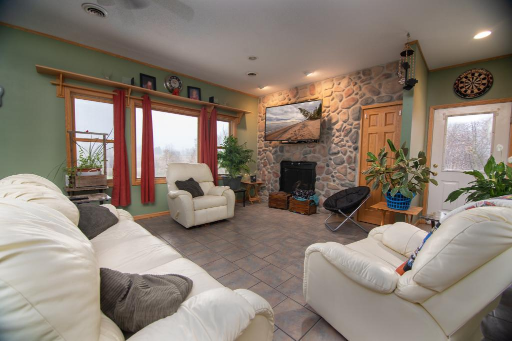 This is a  must see custom built home that boasts character throughout the home.Attention to detail proves itself through stone fire place, in-floor heat throughout and its open floor plan. 30x40 patio with built in fire pit to sit around and enjoy those nights  by the fire. Garage is heated and has in-floor heat.This home has  2400 square feet of comfort nestled into 3 acres with a Private setting.School District is Amery or Clayton with no open enrollments to either buyer chooses. Sellers  pay Amery school tax and have kids in Clayton school district.
