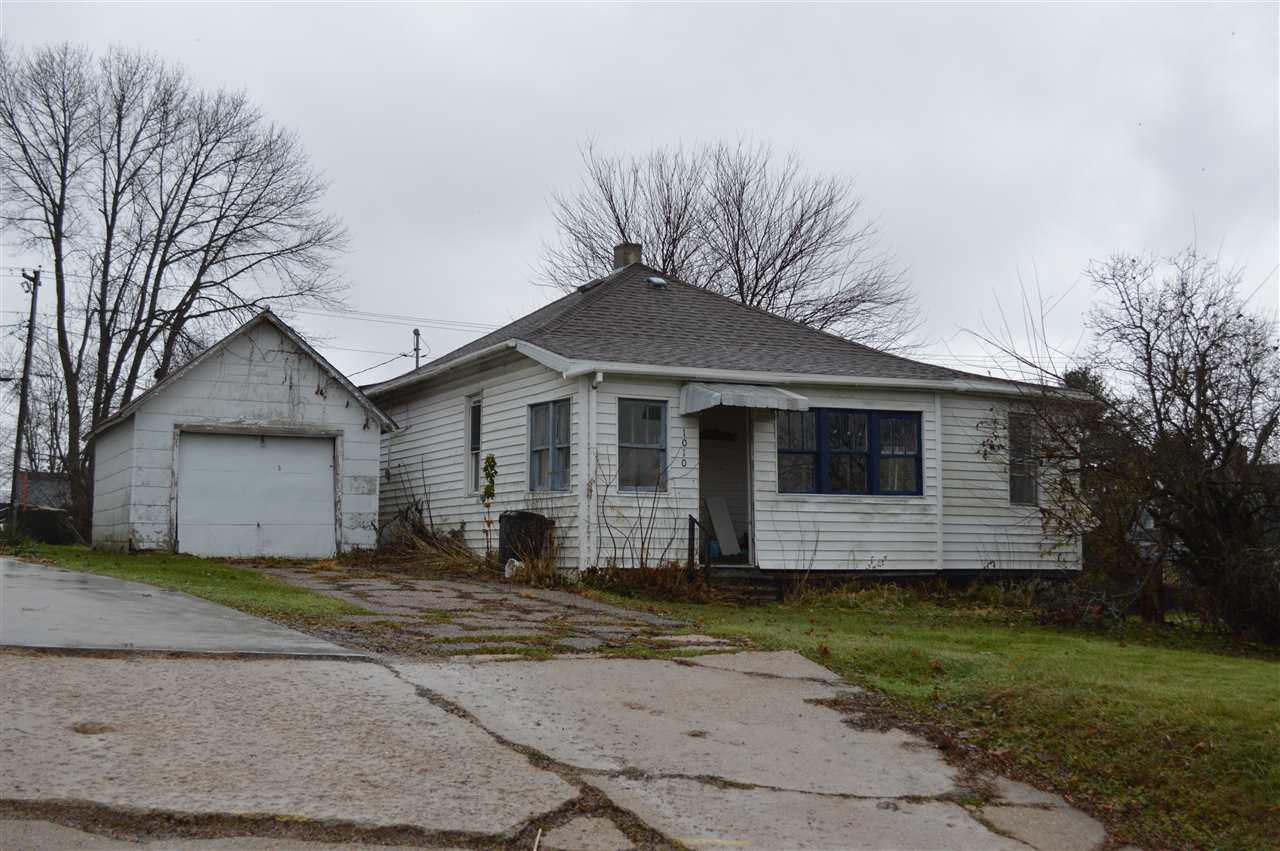 Calling all fixer-uppers and investors! Hillside home on a corner lot in the heart of Plain, ready to either be improved! 2 bed, 1 ba with a nice sized kitchen & covered front porch. 1 car detached garage, large lot with spacious backyard. Price under the assessed value.