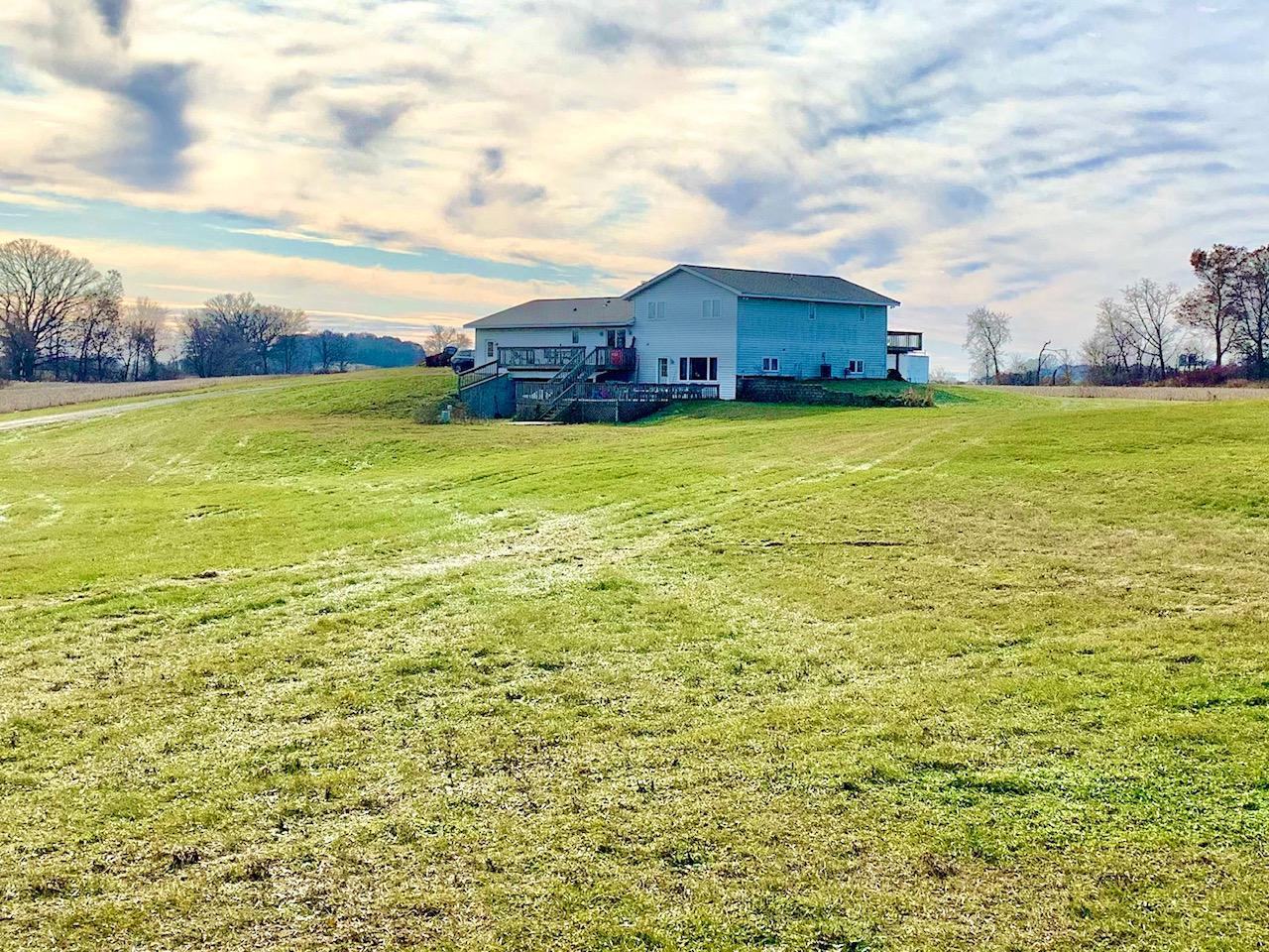 BEST OF ALL WORLDS!  ALMOST 20 ACRES,  BEAUTIFUL 3000+ SQ FT HOME, 60' X 120' DREAM SHOP (ZONED COMMERCIAL) , LEGAL AIRPORT WITH ALMOST 1800' GRASS RUNWAY!!!!HOME FEATURES HUGE CUSTOM KITCHEN-WOOD WORK-CABINETS + 12' X 25' DECK, FIRST FLOOR LAUNDRY,MASTER SUITE, NATURAL FIREPLACE, FANTASTIC 20 X 37 REC ROOM W/WET BAR AND FLOOR HEAT!  HOME HAS MULTIPLE HEAVY DUTY DECKS, AND A HEATED 3 CAR GARAGE! IF THIS IS NOT ENOUGH TO WOW YOU...THIS HOME HAS A 3 YR OLD ROOF,CABLE TV, HIGH SPEED INTERNET AND NATURAL GAS AVAILABLE!!! NEXT THE SHOP IS ACTUALLY ZONED COMMERCIAL!!! THERE IS TOO MUCH TO LIST BUT...480/400 AMP,DOORS: 18' X 10', 9' X 10' W/LOADING DOCK & 44' X 11 HANGER DOOR, RADIANT HEAT, FULL BATH, OFFICE, 1 YR OLD ROOF, 2 X 6 CONSTRUCTION, 4'' VACUUM LINE + APPROX 10 ACRES RENTED $700/Y