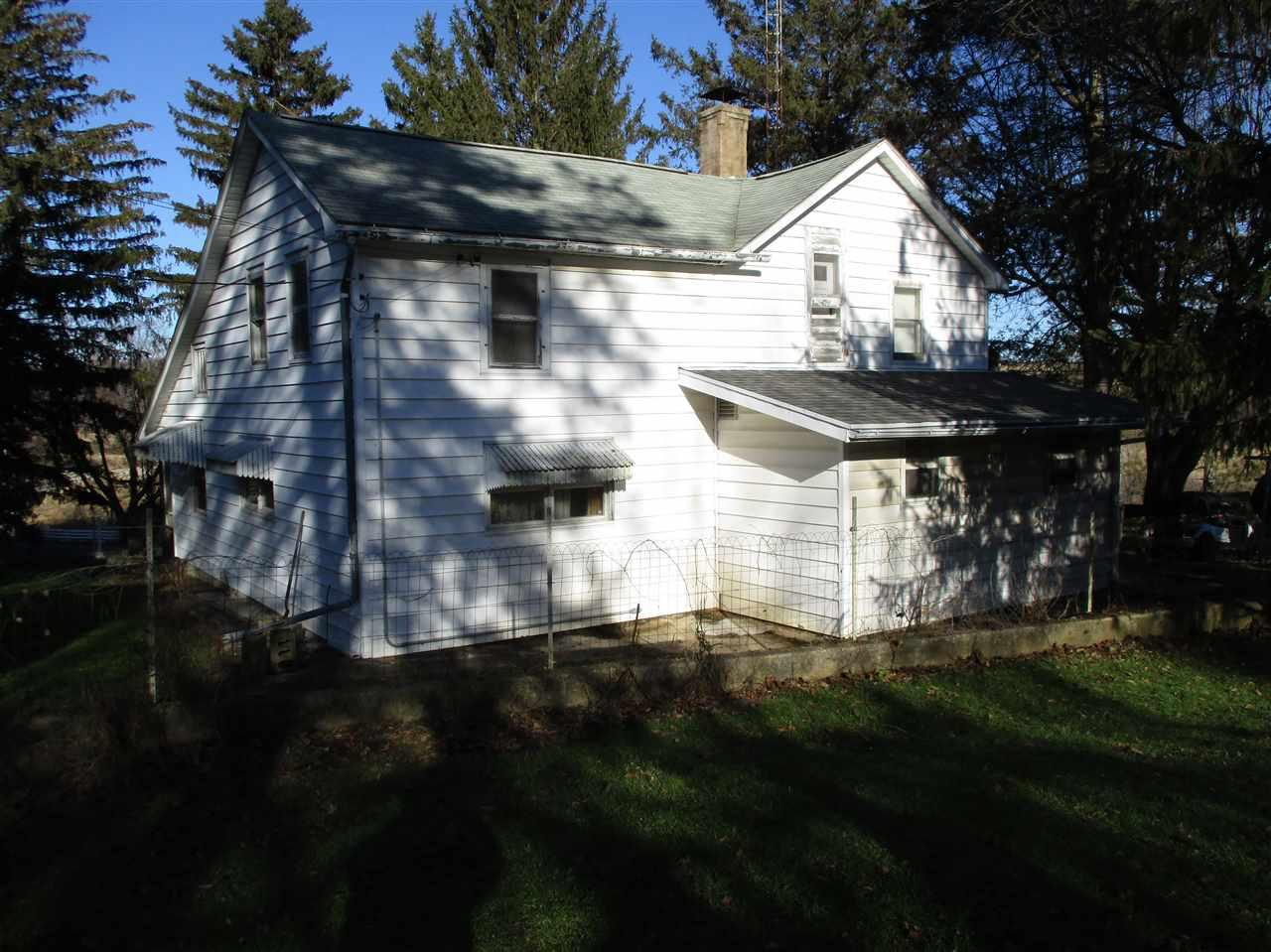 182.56 acres farmland with 96.84 acres pasture/woods/creek bottom and woods with peaceful quiet setting.  Several outbuildings and craftsman style house from early 1900's fair condition, but needing updates.