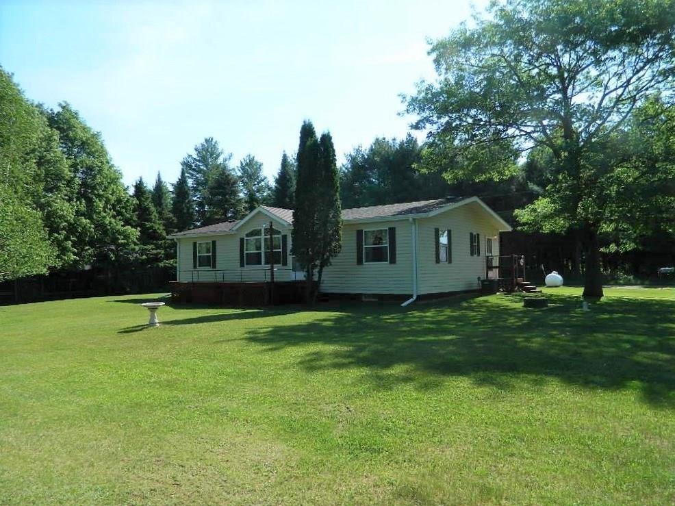 Enjoy exceptional views year round of the Radisson Flowage from this well-maintained home. Located on a quiet dead end road w/ a spacious yard, 250' of frontage, two decks, full basement, and an oversized 2 car garage. The home has had several updates over the last few years which include: new roof on the home & garage, gutters, appliances, and sump pump. The Radisson Flowage is known for its great fishing and flows into the Chippewa River. Access nearby to the Tuscobia Snowmobile/ATV trail.
