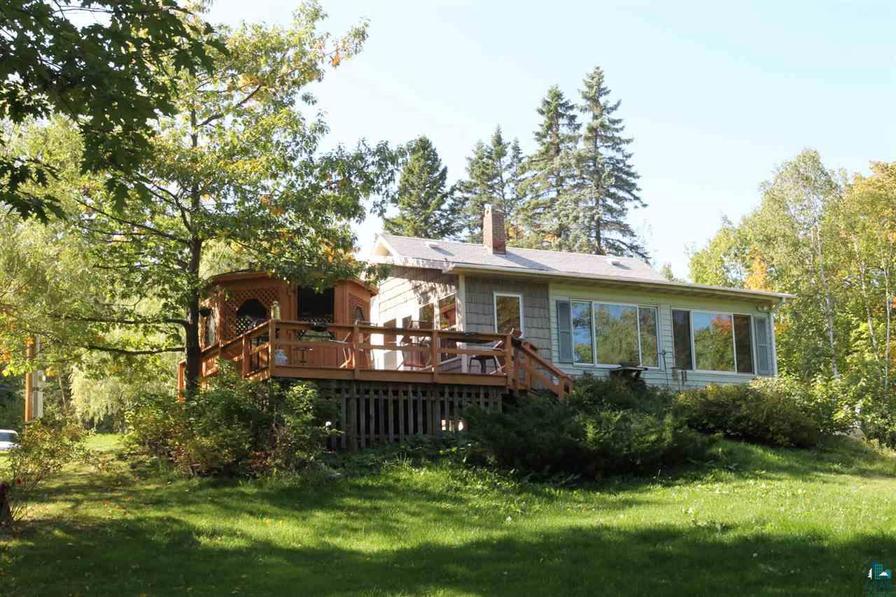 Great country home north of Bayfield on Little Sand Bay Road; only one mile from Little Sand Park and Lake Superior.  Nicely wooded acreage.  One level 2 bedroom, 2 bath home with a living room/family room, outside screened gazebo, and a 3 car detached garage.