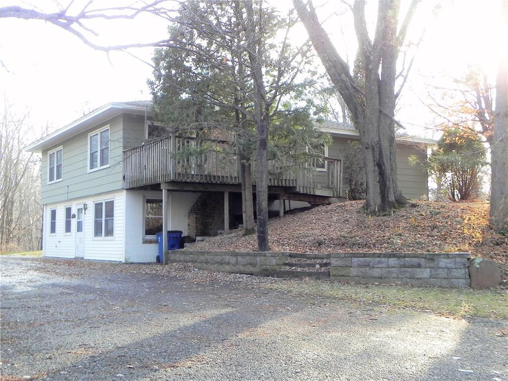 Beautiful 3BR/2BA home on 5 wooded acres NW of Frederic. Home features huge living room, open kitchen/dining room area with built-in buffet, 3 main floor bedrooms, 2 main floor bathrooms, main floor laundry plus partial, walk-out basement with big family room & wood burning, brick fireplace to enjoy. Blacktop driveway and big 26x28 2-car detached garage for parking & extra storage. 5 acre parcel is rolling and heavily wooded. Great property in a great location - come see!